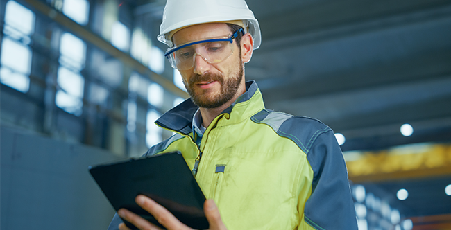 Worker using Axora Technology to improve health and safety
